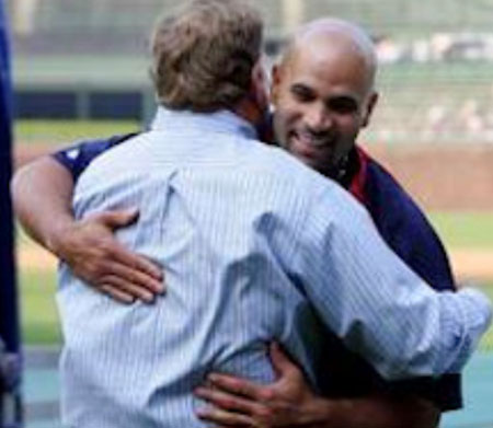 Jim Hendry hugging Albert Pujols